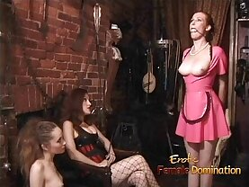 Two latex clad harlots spank a ginger bitch before having some fun themselves